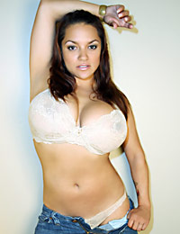 Monica Mendez in tan bra and blue jeans